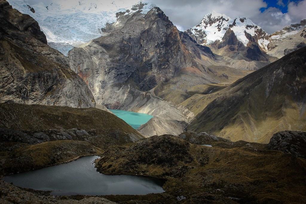 Alpine splendisism. Azure Laguna Jancarurish is fed by the massive glaciers of Alpamayo (5947m) and Quitaraju (6036m), both out of sight. Santa Cruz Grande (6241m) appears at the right. Huascaran National Park. Cordillera Blanca. Peru.