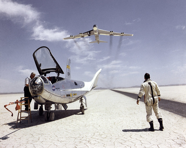 HL-10 on Lakebed with B-52 flyby