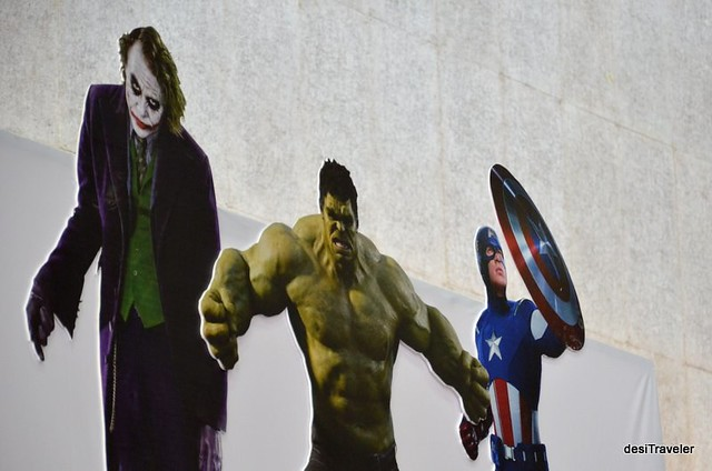 superheroes and joker at comic con