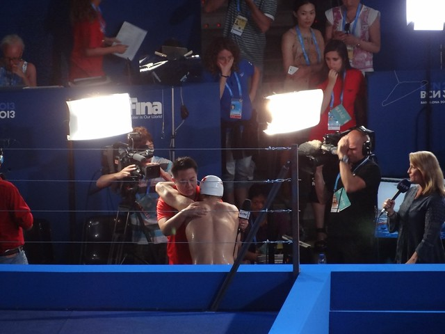 Sun Yang getting a hug after the BCN2013 men's 400 free