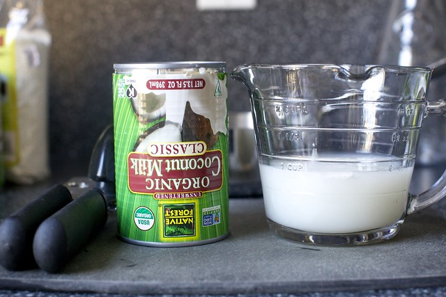 chilled coconut milk, inverted, milk poured off