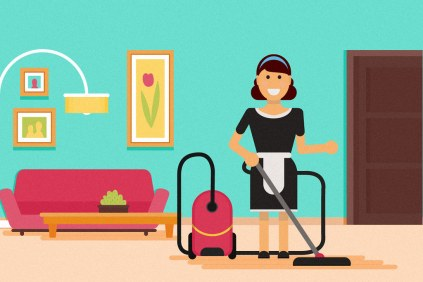 housekeeper vacuuming a living room in a home