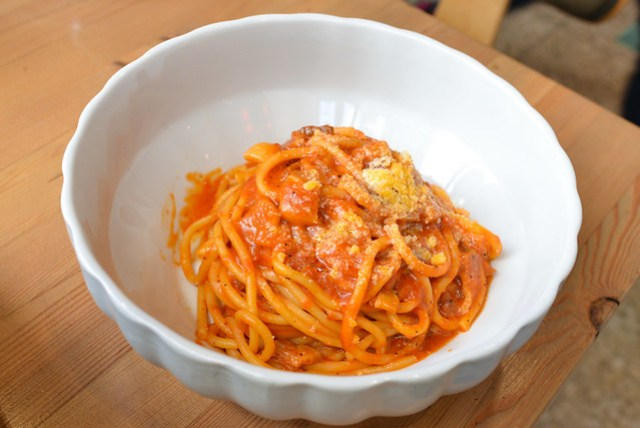 Bucatini all'Amatriciana bucatini with guanciale, onions, tomato sauce, little spice, extra-virgin olive oil and pecorino