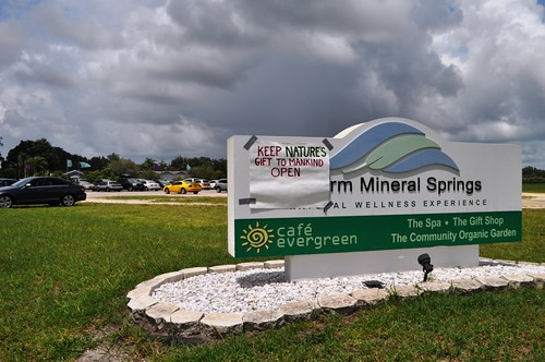 "Handmade sign reads, ""Keep Nature's Gift to Mankind Open,"" on the Warm Mineral Springs sign, North Port, Fla., June 30, 2013."