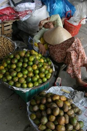 Sleeping Market trader, Hué, Vietnam