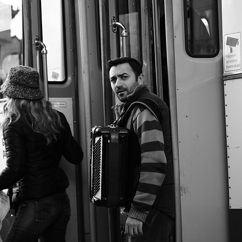 Week 41/52 - A man with his accordion gets off from a tram by Flubie