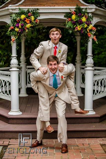 Groom and groomsman take funny photos together