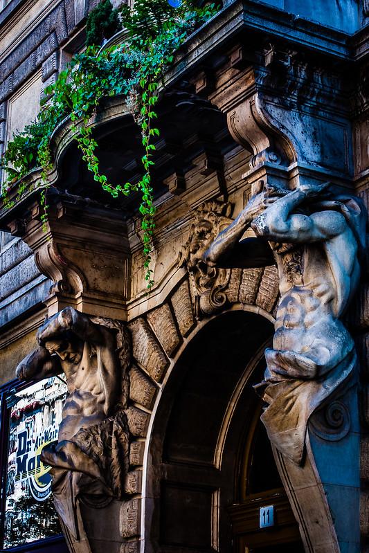 Stone statues holding up balcony, Budapest, Hungary