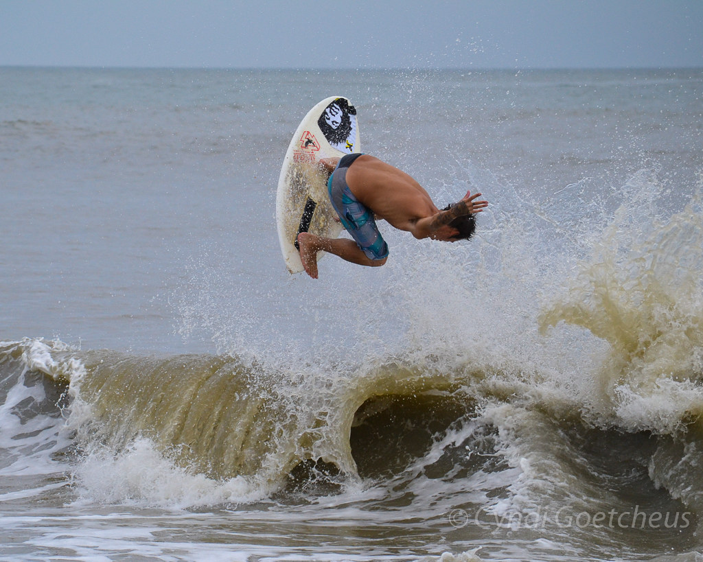 skimboarder in air