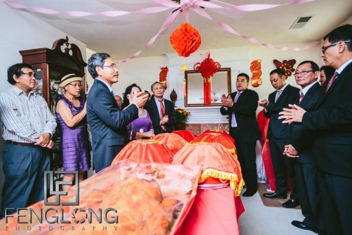 Families exchange gifts during Vietnamese wedding tea ceremony