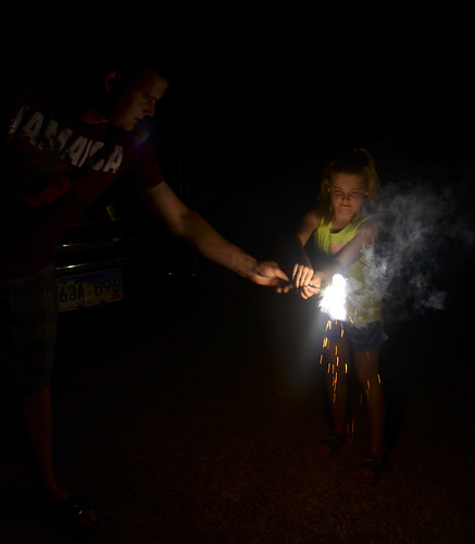 Leon gets a sparkler ready for Kaitlyn