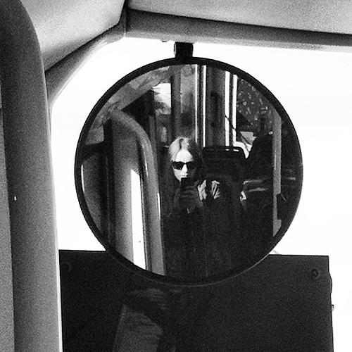 Selfie in a bus mirror, a la @lilliendahl