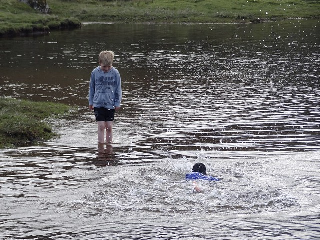 Young kid taking a dip in our local lake
