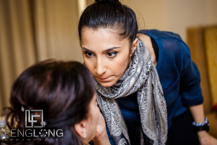Noor with Noordace applying makeup to the bride