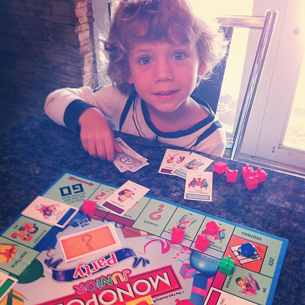 "Finn's plays his first game of Monopoly (Monopoly Junior Party edition). The ""properties"" are bounce houses, dance parties, and magic shows, but it's still about competition and luck. (Sigh)."