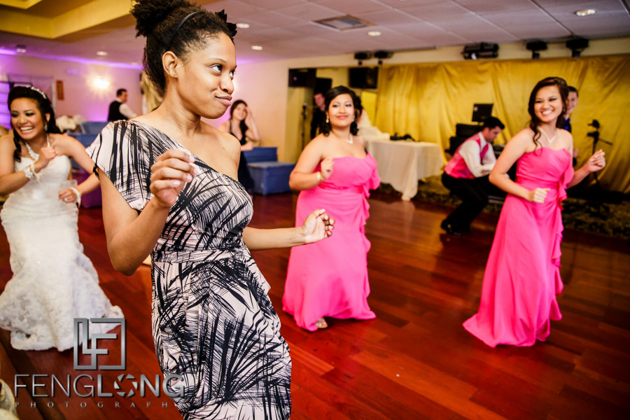 Bride and friends practice dance routine for reception