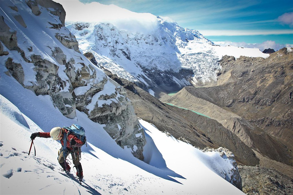 Climbing up Urus Este (5420m), while clouds swallow our next objective Tocllaraju (6032m). Cordillera Blanca. Peru.