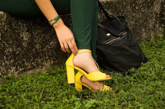 green cigarette pants, yellow t-strap heels, black Victoria's Secret bag