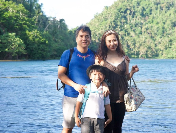 family photo against Lake Pandin in San Pablo