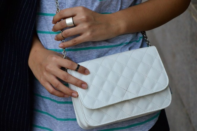 striped green tank top, delicate small silver rings, white cross body bag