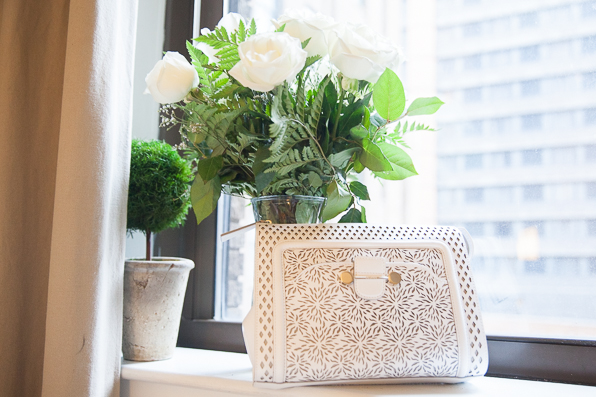 Laser cut leather Jason Wu clutch bag in Bryanboy's apartment