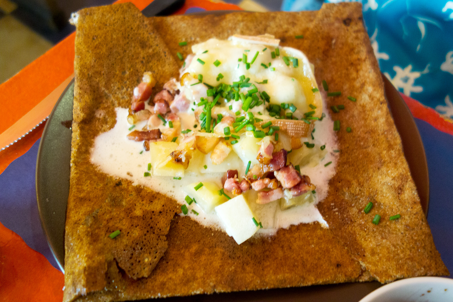 Crepe deliciousness. Potatoes, multiple kinds of cheese and bacon.