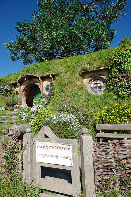 The yellow door house seems to get the most press, but the house everyone wants to see is Bilbo Baggins' house. The green door and fake tree are dead give aways.