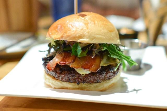 Kiki's Burger Angus Beef, Sautéed Shiitake, Enoki & Eryngii Mushrooms, Caramelized Bacon, Sweet Onion Marmalade, Gruyere Cheese, Garlic Chili Aioli