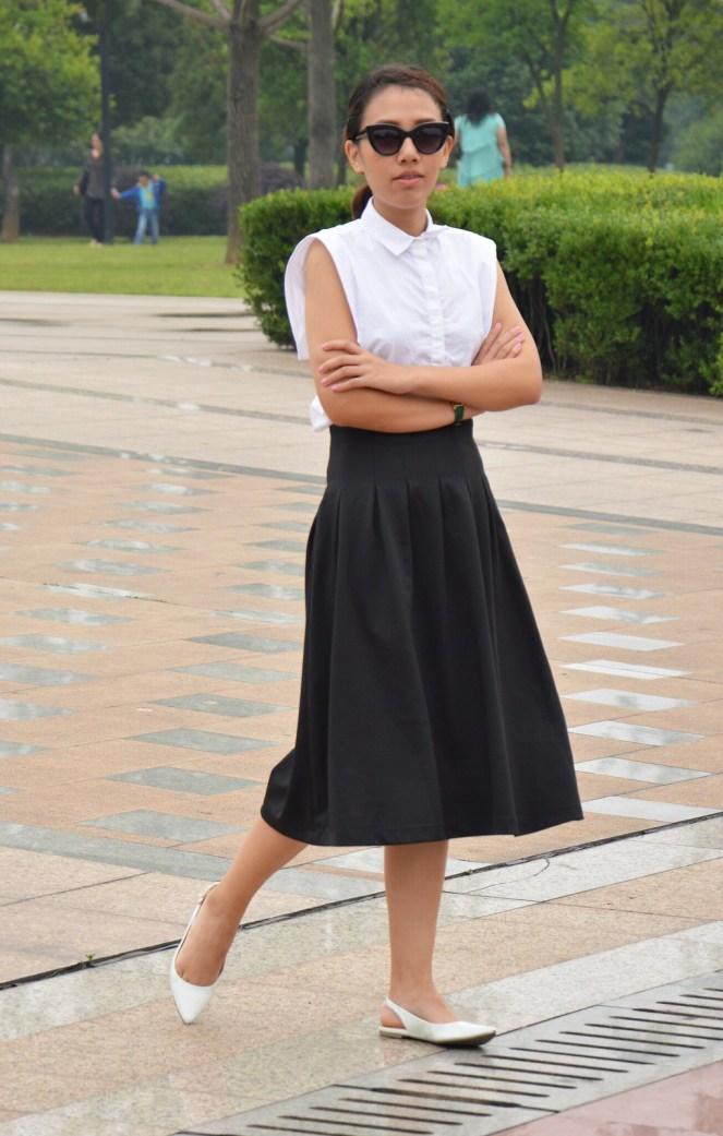 Mango white collared blouse, green gucci watch, black midi skirt, pointed toe flats