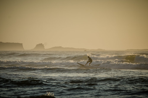 Cape Arago and Surfer from Bastendorf Beach