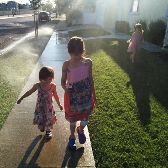 Walking around the neighborhood, getting drenched by the sprinklers...