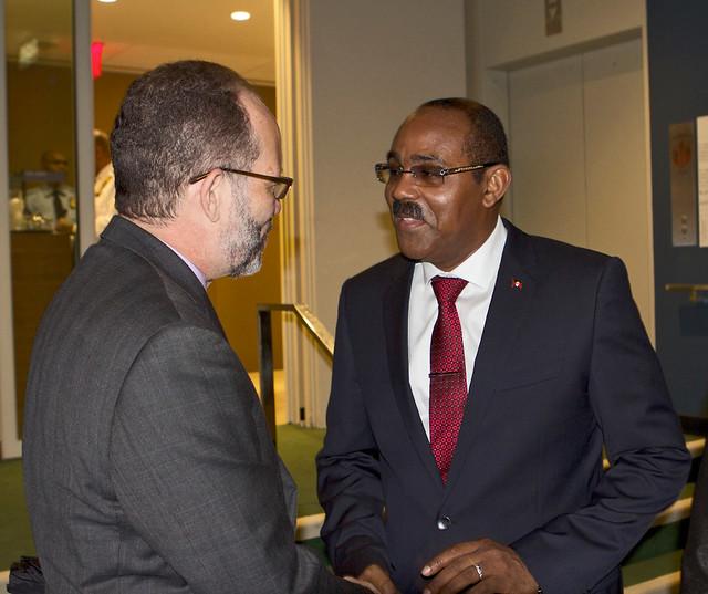 Secretary-General Ambassador Irwin LaRocque congratulates Hon. Gaston Browne, Prime Minister of Antigua and Barbuda and Chairman of CARICOM
