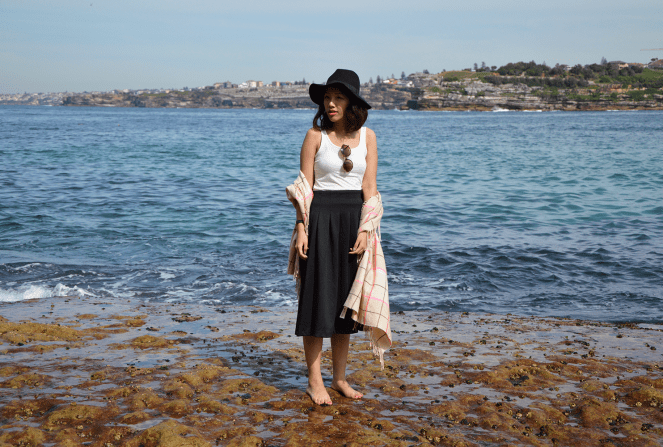 Bondi Beach, Sydney, floppy black hat, checkered scarf, black midi skirt