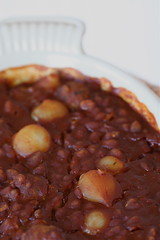 Baked beans with sausage and onions
