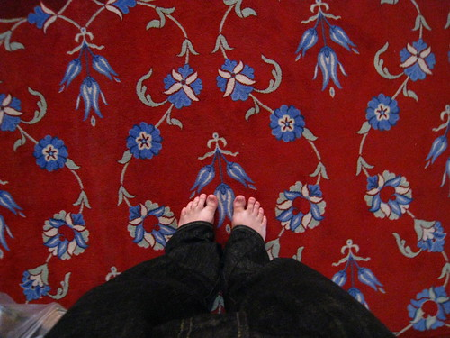 Patterned carpet in the Blue Mosque. Less decorative - my feet.