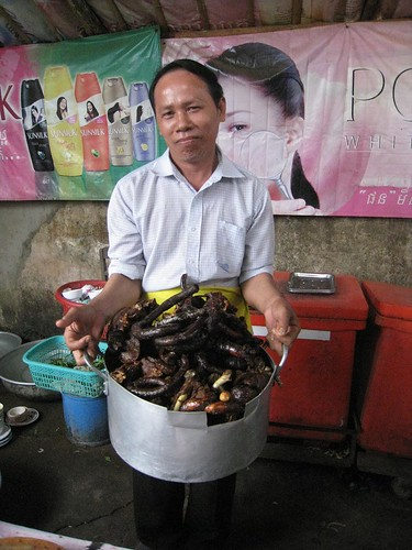 The chef/owner proudly displays his restaurant's dog meat