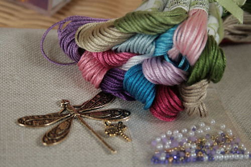 Silks, charms, beads and embellishments