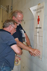 The American Red Cross opened its disaster operations administratvie headquarters in Baton Rouge today in preparations for Tropical Storm Gustav.  Jim Cleveland (back/tall) and Ray Van Slyke, both volunteers from Muskegon, Michigan, help to hang ID banners to prepare the headquarters building.