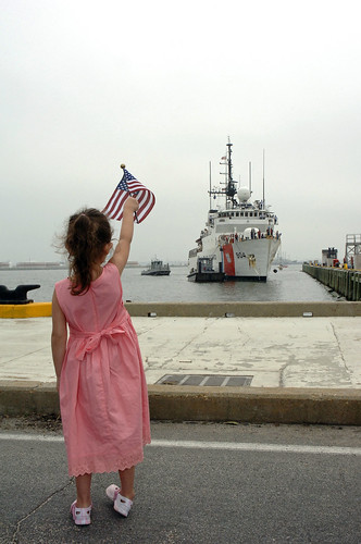 PORTSMOUTH, Va. - Faith Sulton, 5, of Virginia Beach, Va., waves an American flag as she awaits the return of her uncle, Petty Officer 1st Class Jeffrey Reigel, an electronics technician stationed aboard the Coast Guard Cutter Northland. The Northland is returning home after a 69-day patrol participating in the multi-national naval exercise UNITAS off the coast of Brazil and conducting counter-narcotics operations in the Caribbean. (U.S. Coast Guard Photo/ Petty Officer 2nd Class Nathan Henise)