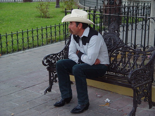 A cowboy waiting for his cowgirl.