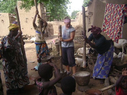Lexi pounds millet in Dogon Country.