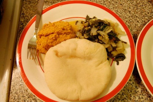 pumpkin hummus, tunisian braised chard, pita