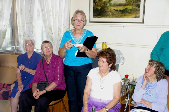 Jo Kann speaking at Bert Nords wake. Norma Nord is seted at right.