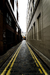 Small street in belfast with yellow lines