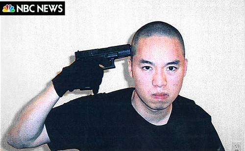 Image of Cho Seung-Hui with a gun to his own head