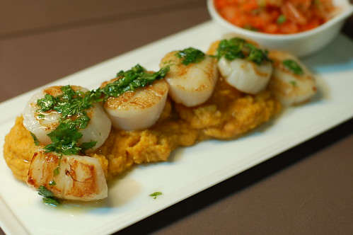 Scallops and cilantro sauce on savory mashed sweet potatoes with Asian slaw