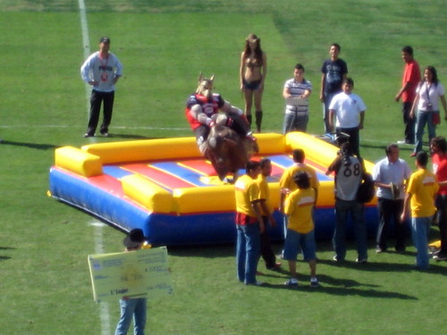 At halftime the mascot rode the mechanical bull