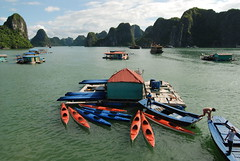 Kayaks docked in Halong Bay...we took one of these out and kayaked in the bay while monsoon rains fell
