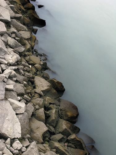 Milky water in Newtown Creek near Grand Avenue Bridge by you.
