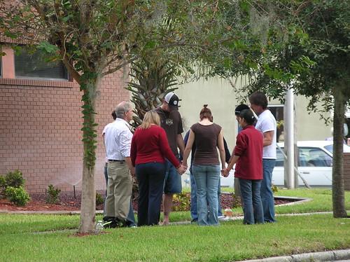 Prayer group in front of EPOC Women's Center